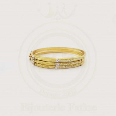 Sertla en trois bracelets très élégante en or 18 carats